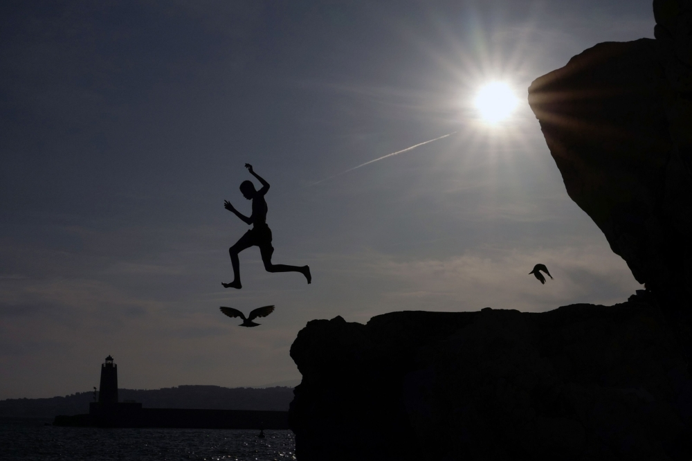 A young man jumps into the Mediterranean Sea on the French Riviera city of Nice, France, in this July 31, 2019 file photo. — AFP