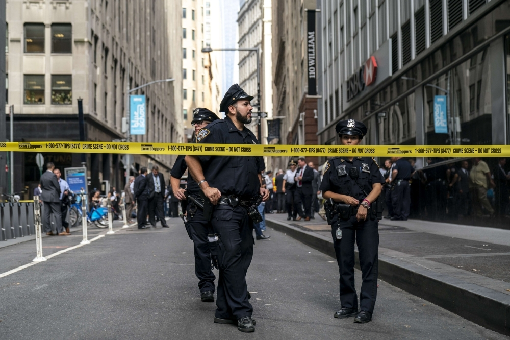 NYPD officers work the scene where there were reports of a suspicious package near the Fulton Street subway station in Lower Manhattan in New York City on Friday. — AFP