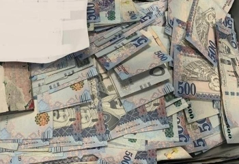 Saudi currency seized from a passenger at Madinah airport. — SPA