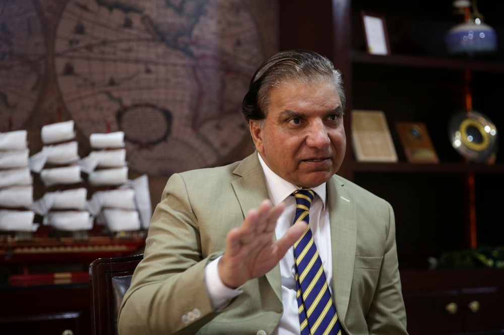 Lt. Gen. (retd) Muzammil Hussain, chairman of the Water and Power Development Authority (WAPDA), gestures during an interview at his office in Islamabad, Pakistan, on Monday. — Reuters