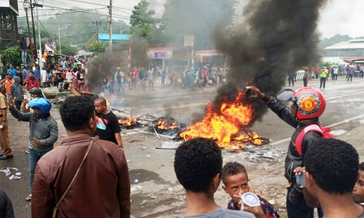 People burn tires during a protest at a road in Manokwari, West Papua, Indonesia on Monday. -Courtesy photo