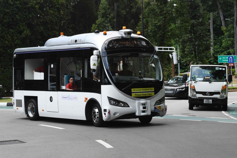 An on-demand autonomous shuttle bus plies the road during the official launch of a public trial run at Sentosa island resort in Singapore on Tuesday. -AFP