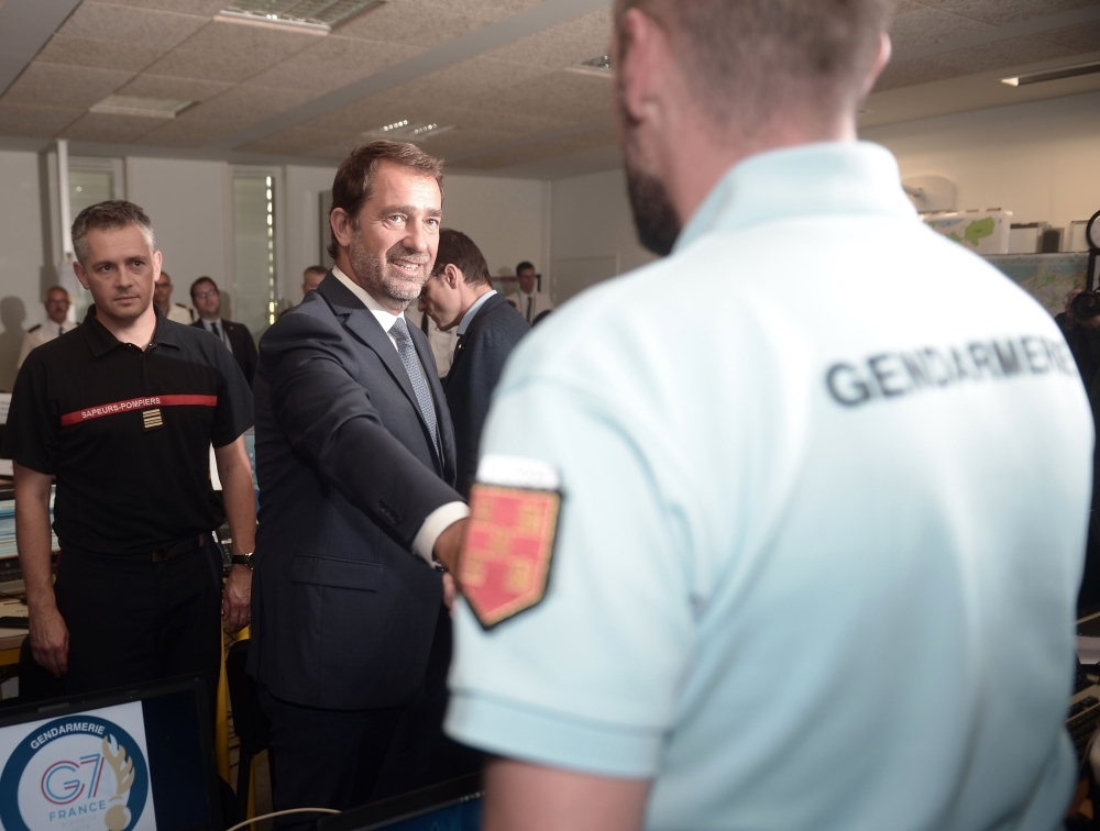 French Interior Minister Christophe Castaner shakes hands with a Gendarme as he arrives at the G7 Interministerial command headquarters (Poste de Commandement Interministeriel - PCI) set in the Fall college in Biarritz on Tuesday ahead of the 45th Group of Seven (G7) nations annual summit which will take place from August 24-26, 2019 in the seaside resort of Biarritz. — AFP