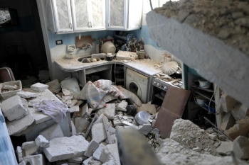 Blocks of cement and rubble are scattered in the kitchen of a house after it was hit during reported air strikes by pro-regime forces in the village of Beinin, north of Maaret Al-Numan, in the northern Idlib province, on Tuesday. — AFP