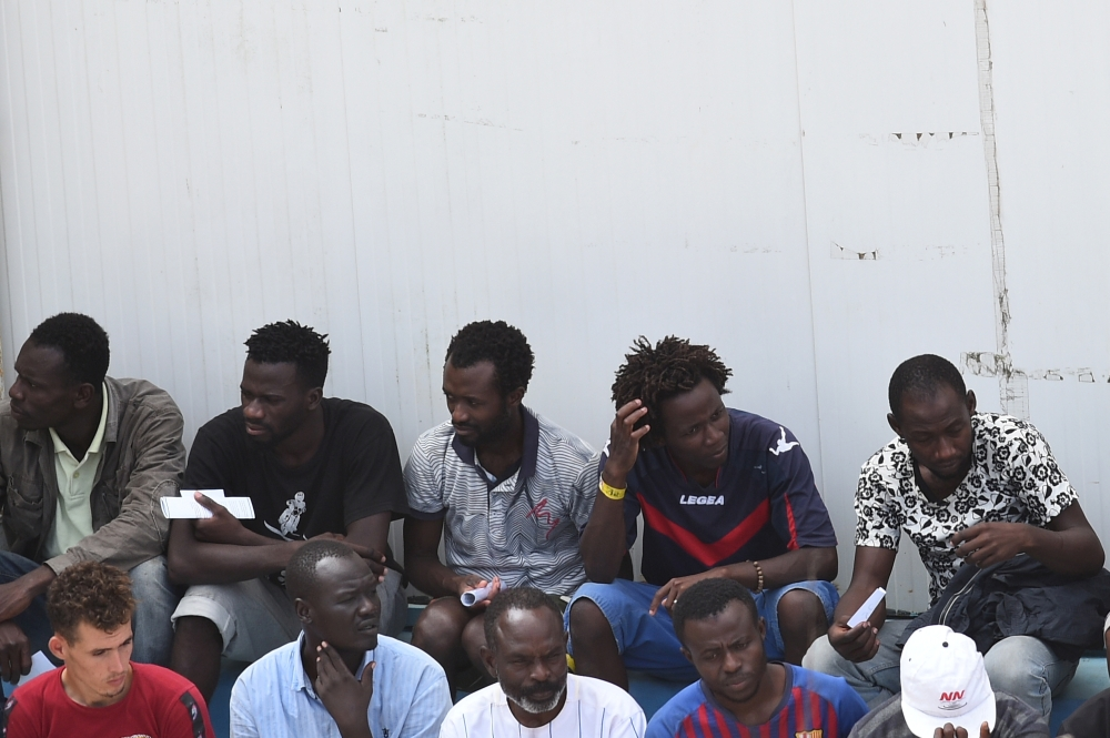 Migrants, some of whom disembarked from Spanish rescue ship Open Arms NGO, are seen at the immigration centre on the southern Sicilian island of Lampedusa, Italy, on Wednesday. — Reuters