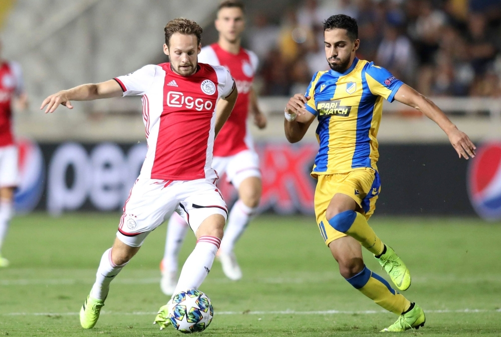 Ajax's defender defender Daley Blind (L) vies for the ball with APOEL's midfielder Musa Suliman during the UEFA Champions League playoff football match between Cyprus' APOEL Nicosia and Netherland's Ajax Amsterdam at the GSP stadium in Nicosia, on Tuesday. — AFP