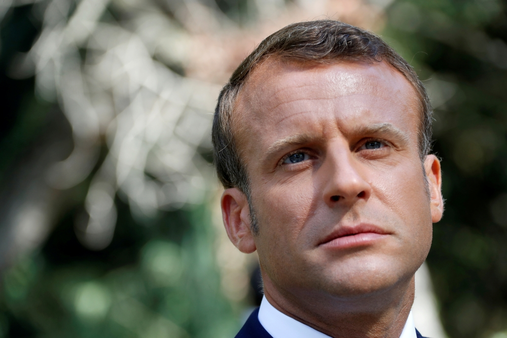 French President Emmanuel Macron reacts as he arrives at a ceremony marking the 75th anniversary of the Allied landings in Provence in World War II which helped liberate southern France, in Boulouris, France, in this Aug. 15, 2019 file photo.  — Reuters