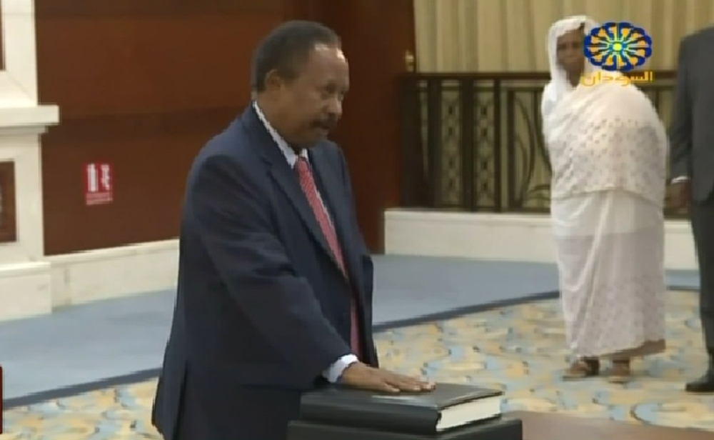 This screen grab taken from Sudan TV on Wednesday shows Abdallah Hamdok during a swearing in ceremony in the Sudanese capital Khartoum.  — AFP