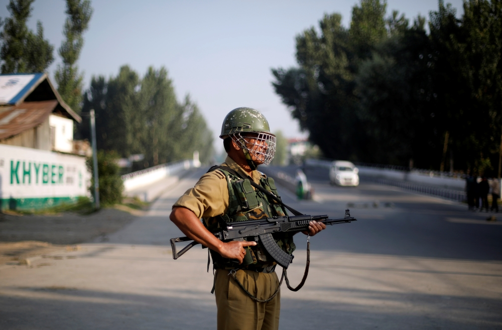 An Indian security personnel stands guard on a deserted road during restrictions after scrapping of the special constitutional status for Kashmir by the Indian government, in Srinagar, India, on Friday. — Reuters