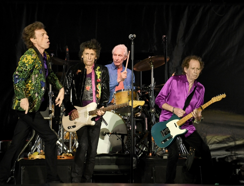 Mick Jagger, left, Ronnie Wood, second left, Charlie Watts, second right, and Keith Richards, right, of The Rolling Stones perform onstage at Rose Bowl in Pasadena, California, on Thursday. — AFP