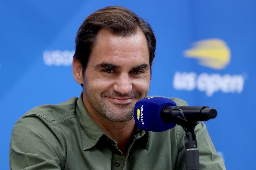 Roger Federer of Switzerland fields questions during a press conference at media day prior to the US Open at USTA Billie Jean King National Tennis Center in New York City, on Friday. — AFP