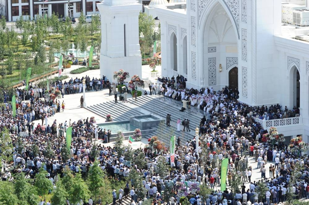 People gather outside a new mosque during an inauguration ceremony, in the Chechen town of Shali, Russia, on Friday. — Reuters