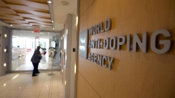 A woman walks into the head office of the World Anti-Doping Agency (WADA) in Montreal, Quebec, Canada, in this Nov. 9, 2015 file photo. — Reuters