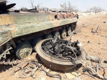 A damaged military tank is seen in Idlib countryside, Syria in this handout released by SANA, on Thursday. — Reuters