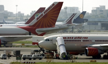 Air India aircraft stand on the tarmac at the airport in Mumbai, India, in this Sept. 27, 2009 file photo. — Reuters