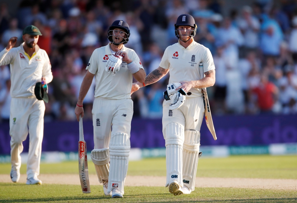 England's Joe Root and Ben Stokes leave the pitch after the third day of play against Australia at Headingley, Leeds, Britain, on Saturday. — Reuters