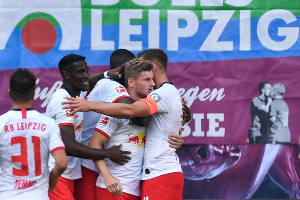 Leipzig's German forward Timo Werner (2nd R) celebrates after scoring the 1-0 during the German first division Bundesliga football match RB against Eintracht Frankfurt in Leipzig, eastern Germany, on Sunday. — AFP