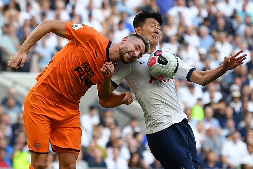 Newcastle United's Welsh defender Paul Dummett (L) vies with Tottenham Hotspur's South Korean striker Son Heung-min (R) during the English Premier League football match between Tottenham Hotspur and Newcastle United at Tottenham Hotspur Stadium in London, on Sunday. —  AFP