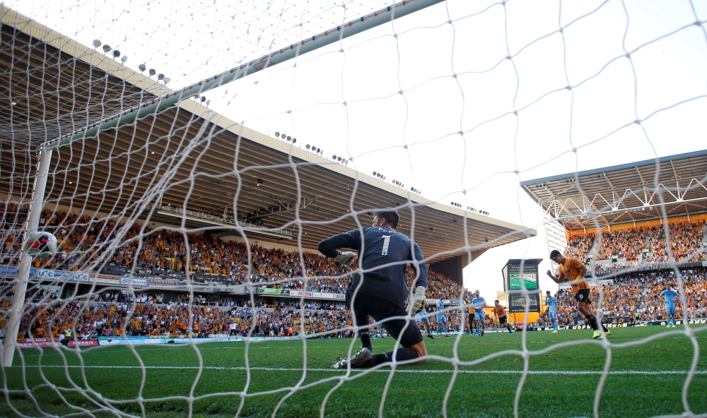 Wolverhampton Wanderers' Raul Jimenez scores their first goal from the penalty spot during the Premier League match against Burnley at Molineux Stadium, Wolverhampton, Britain, on Sunday. — Reuters
