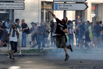 A man lobs a stone during a protest in the city of Bayonne, south-west France on Saturday, on the sidelines of the annual G7 Summit attended by the leaders of the world's seven richest democracies, Britain, Canada, France, Germany, Italy, Japan and the United States taking place in the seaside resort of Biarritz. -Courtesy photo