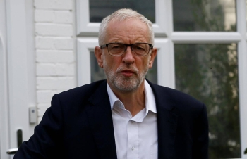 Britain's opposition Labour Party leader Jeremy Corbyn leaves his home in London on August 19. -Reuters