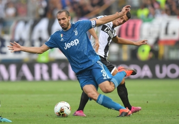 Juventus' Giorgio Chiellini in action with Parma's Roberto Inglese during Serie A match at Stadio Ennio Tardini, Parma, Italy, on Saturday. — Reuters