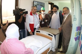 Iranian Haj officials visit a sick Iranian pilgrim in Al-Noor Specialist Hospital, Makkah. — SPA