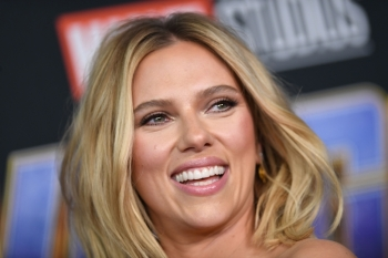 US actress Scarlett Johansson arrives on stage for the Marvel panel in Hall H of the Convention Center during Comic Con in San Diego, California. (File photo)