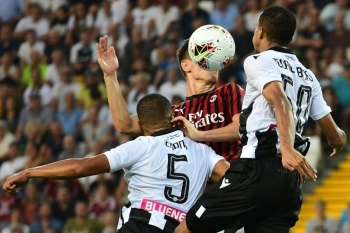 (From L) Udinese's Nigerian defender William Troost-Ekong, AC Milan's Polish forward Krzysztof Piatek and Udinese's Brazilian defender Rodrigo Becao go for a header during the Italian Serie A football match Udinese vs AC Milan at the Friuli stadium in Udine, on Sunday. — AFP