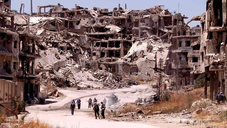 Workers collect the rubble of damaged buildings to be recycled and reused for reconstruction, under the supervision of the United Nations Development Program (UNDP) in the Homs, Syria.  –Courtesy photo