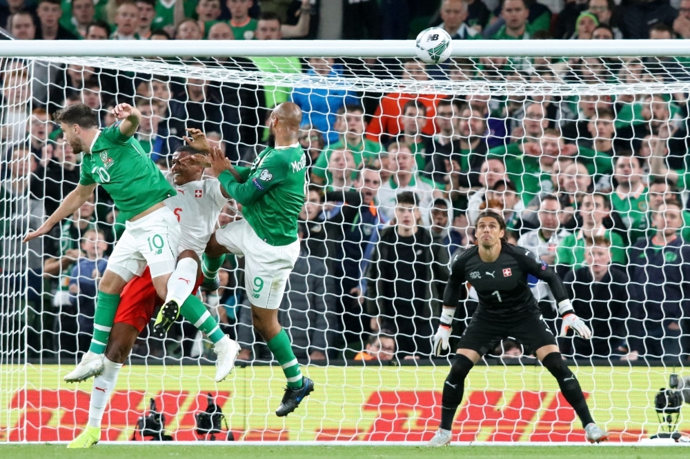 Republic of Ireland's striker David McGoldrick (C) climbs to head home the Irish equalizer during the Euro 2020 football qualification match between Republic of Ireland and Switzerland at Aviva Stadium in Dublin, Ireland on Thursday. The game finished 1-1. — AFP