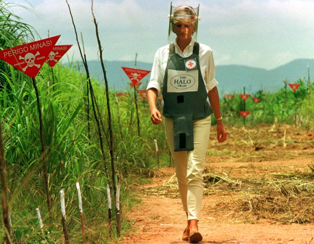 Diana, Princess of Wales, is seen in this Jan. 15 1997 file picture walking in one of the safety corridors of the land mine fields of Huambo, Angola, during her visit to help a Red Cross campaign to outlaw landmines worldwide. — File photo