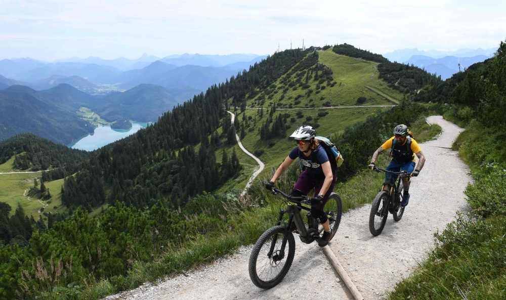 This file photo taken on August 5, 2019 shows Ursula and Robert Werner cycling on their electric bikes as they are on their way up to the Herzogstand mountain in the Alp mountains near the village Walchensee, southern Germany. -AFP