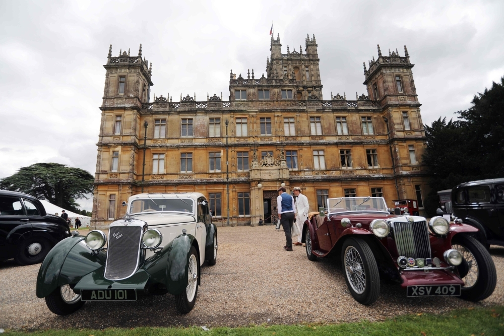 Visitors attend a 1920's themed event at Highclere Castle, near Newbury, west of London, on Saturday, ahead of the world premiere of the Downton Abbey film. -AFP