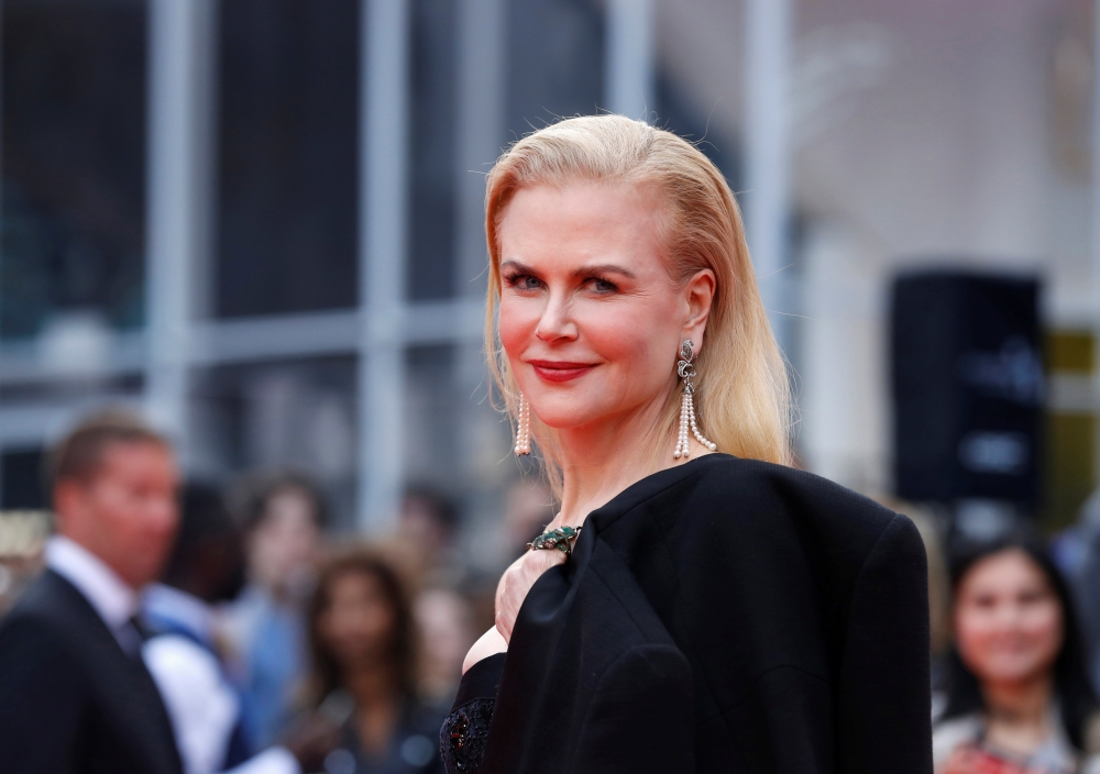 Nicole Kidman poses as she arrives at the world premiere of the drama