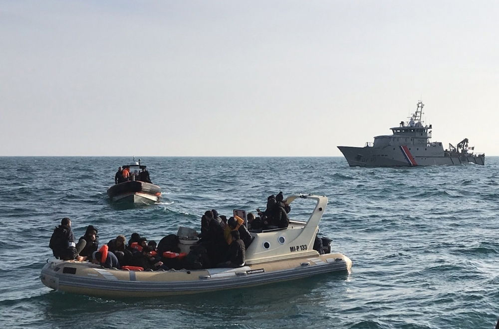 British rescuers, front help some 20 migrants on a semi-rigid boat trying make their way from France across the English Channel in this Feb. 18, 2019 file photo. — AFP