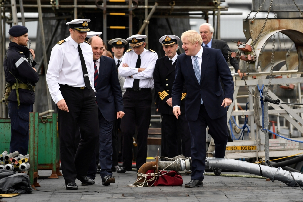 Britain's Royal Navy Commander Justin Codd accompanies Prime Minister Boris Johnson and Defense Secretary Ben Wallace as they visit HMS Victorious at HM Naval Base Clyde in Faslane, Scotland, Britain July 29, 2019. — Reuters
