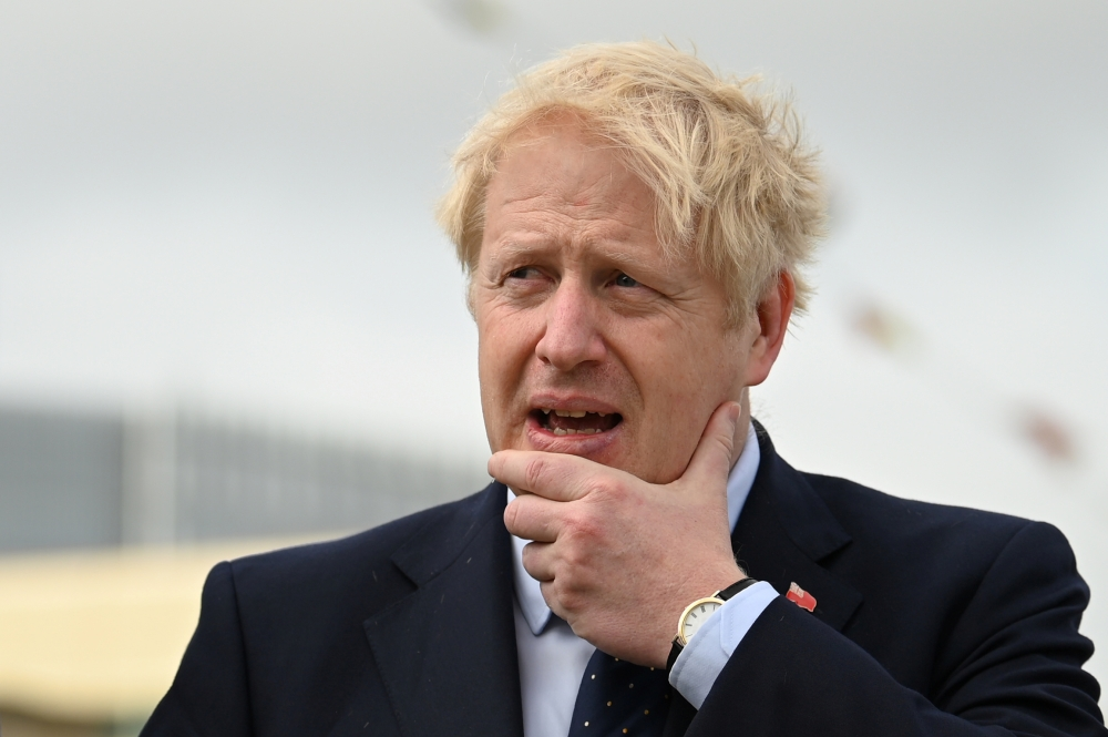 Britain's Prime Minister Boris Johnson visits the NLV Pharos, a lighthouse tender moored on the river Thames to mark London International Shipping Week in London, Britain, on Thursday. — Reuters