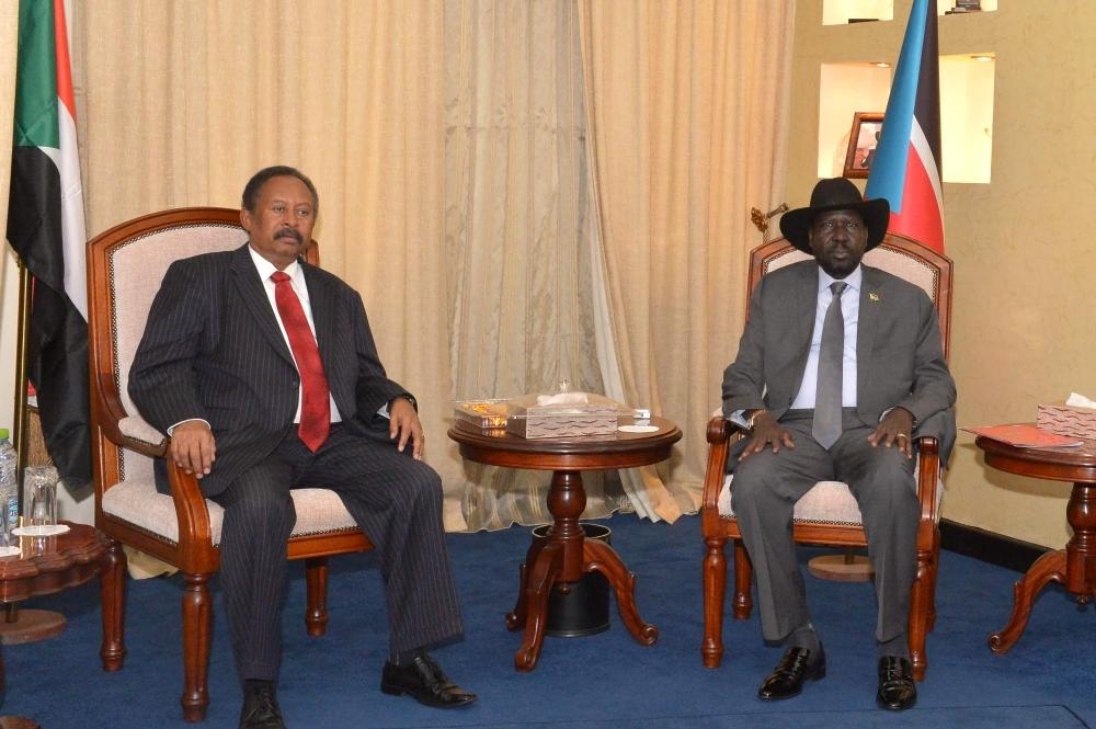 Sudan's Prime Minister Abdalla Hamdok, left, and South Sudan's President Salva Kiir Mayardit meet in the capital city of Juba, South Sudan, on Thursday. — AFP