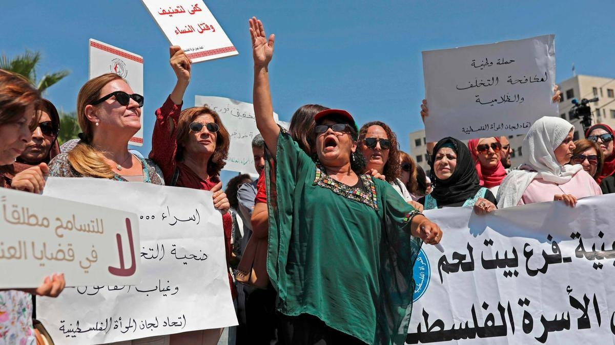 Palestinian women protest in support of women's rights outside the prime minister's office in the West Bank city of Ramallah in this Sept. 2, 2019 file photo. AFP