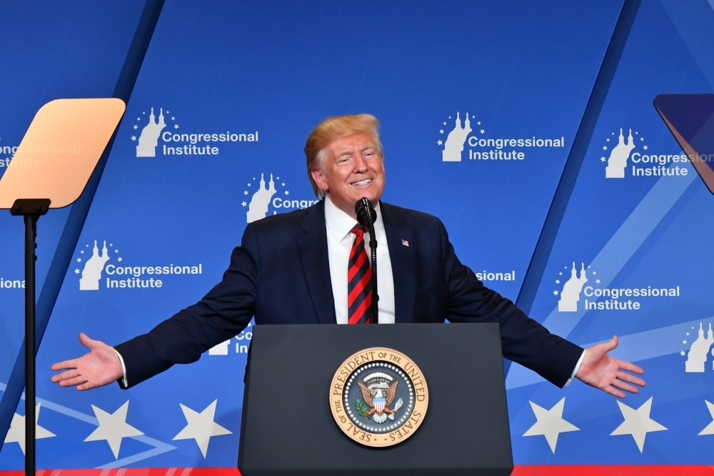 US President Donald Trump delivers remarks during the 2019 House Republican Conference Member Retreat Dinner in Baltimore, Maryland, on Thursday. — AFP