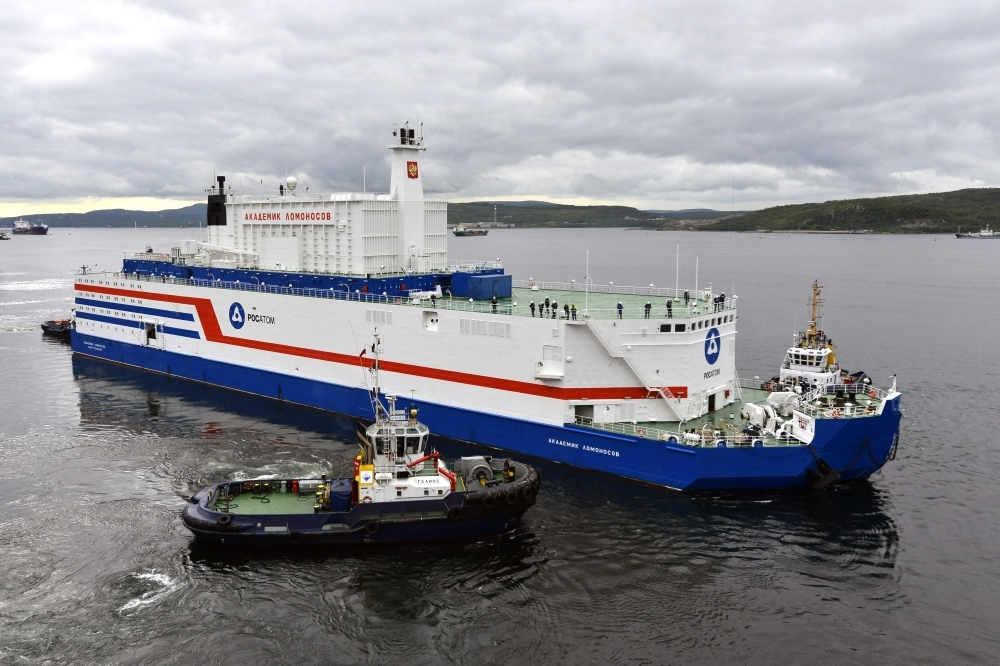 This file handout picture taken and released on Aug. 23, 2019, by the Russian nuclear agency ROSATOM shows the floating power unit (FPU) Akademik Lomonosov being towed from the Arctic port of Murmansk, northwestern Russia. The world's first floating nuclear power plant, developed by Russia, arrived on Saturday at its permanent parking port in Pevek, Russia's Far East, after traveling 5,000 kilometers in the Arctic. — AFP