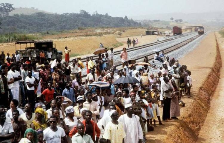 In this file photo taken on January 18, 1983, Gabonese take part in the inauguration of second section Ndjolé-Boouéthe Trans-Gabon Railway (Transgabonais) in Gabon.  — AFP
