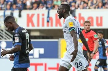 Schalke's Senegalese defender Salif Sane celebrate scoring during the German first division Bundesliga football match Paderborn v Schalke 04 in Paderborn, western Germany, on Sunday. — AFP