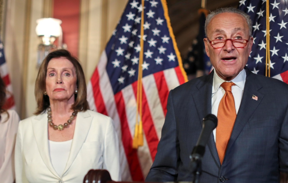 U.S. House Speaker Nancy Pelosi (D-CA) and Senate Minority Leader Chuck Schumer (D-NY) hold a news conference with fellow congressional Democrats to demand that the U.S. Senate vote on the House-passed