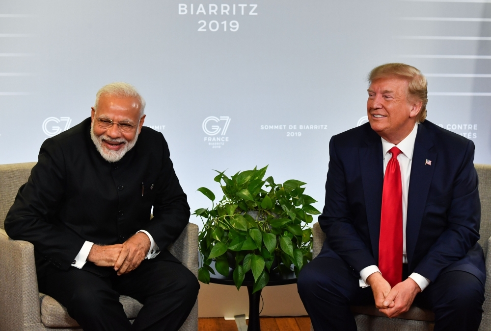 In this file photo taken on August 25, 2019 Indian Prime Minister Narendra Modi and US President Donald Trump speak during a bilateral meeting in Biarritz, southwest France on the third day of the annual G7 Summit. -AFP