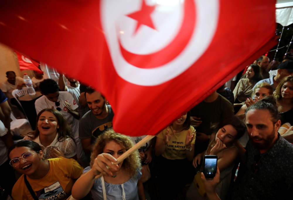 Supporters of detained presidential candidate and Tunisian media mogul Nabil Karoui react after unofficial results of the Tunisian presidential election in Tunis, Tunisia, on Sunday. -Reuters