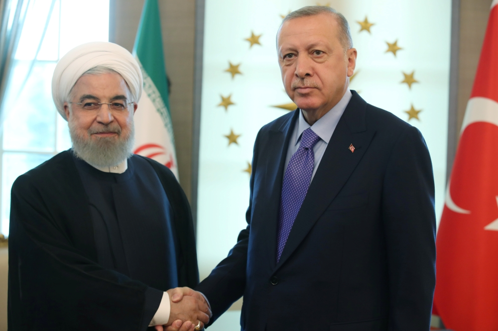 Turkish President Tayyip Erdogan, right, meets with his Iranian counterpart Hassan Rouhani in Ankara, Turkey, on Monday. — Reuters