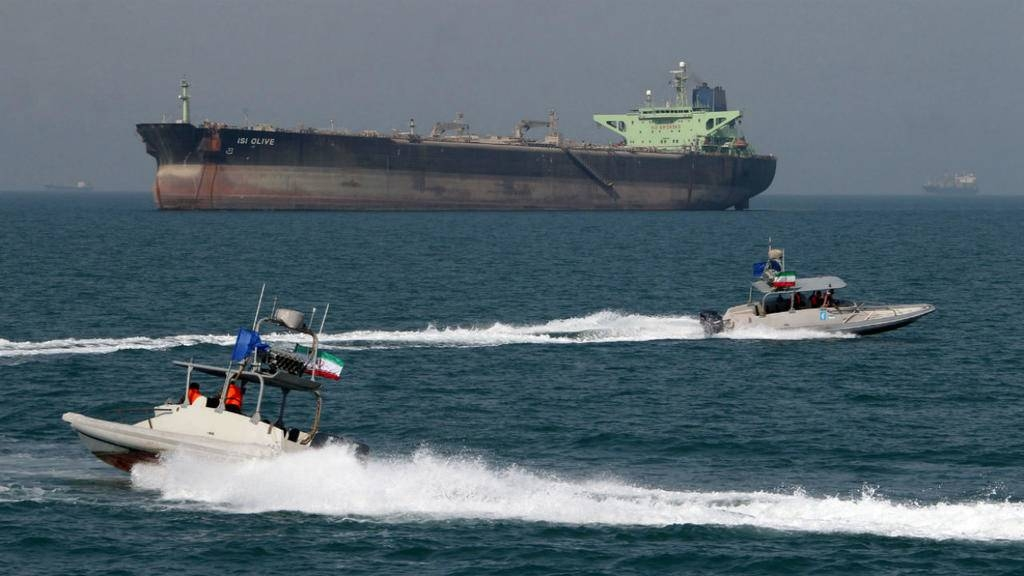 Iranian Revolutionary Guards drive speedboats in front of an oil tanker at the port of Bandar Abbas in this July 2, 2012 file photo. — AFP