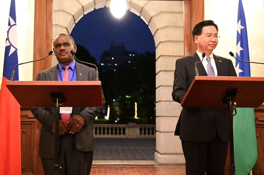 Taiwan's Foreign Minister Joseph Wu, right, takes part in a press conference with Solomon Islands' Foreign Minister Jeremiah Manele, left, at the Taipei Guest House in Taipei in this Sept. 9, 2019 file photo. — AFP